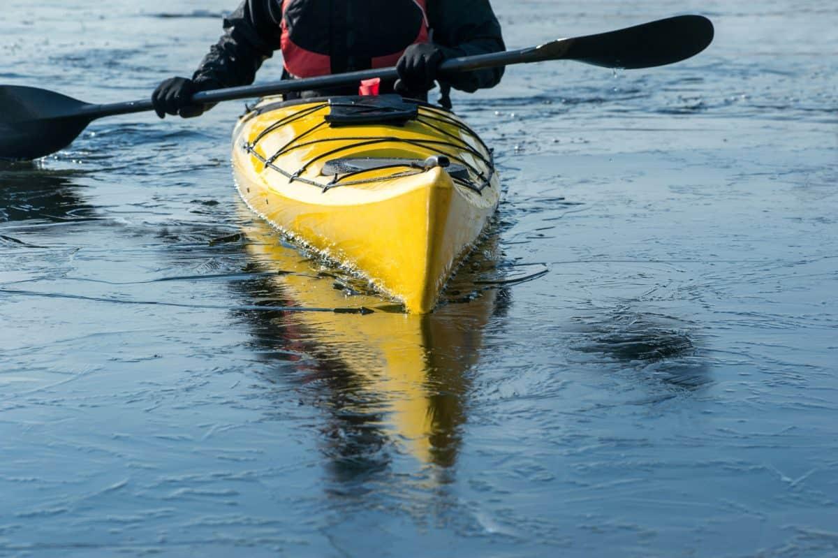 Winter Kayak in dry suit and kayaking gloves