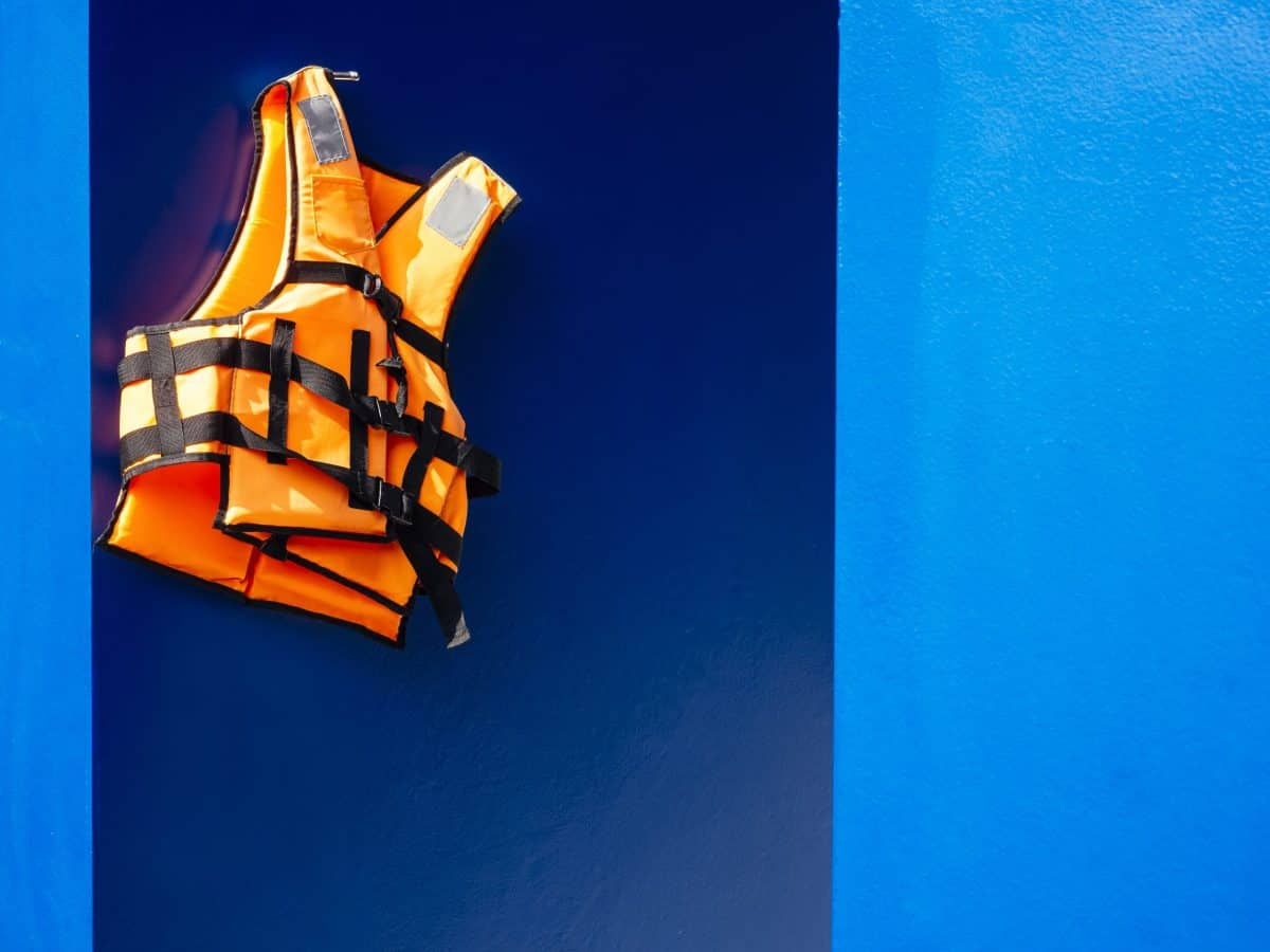 Life Vest hanging on blue wall