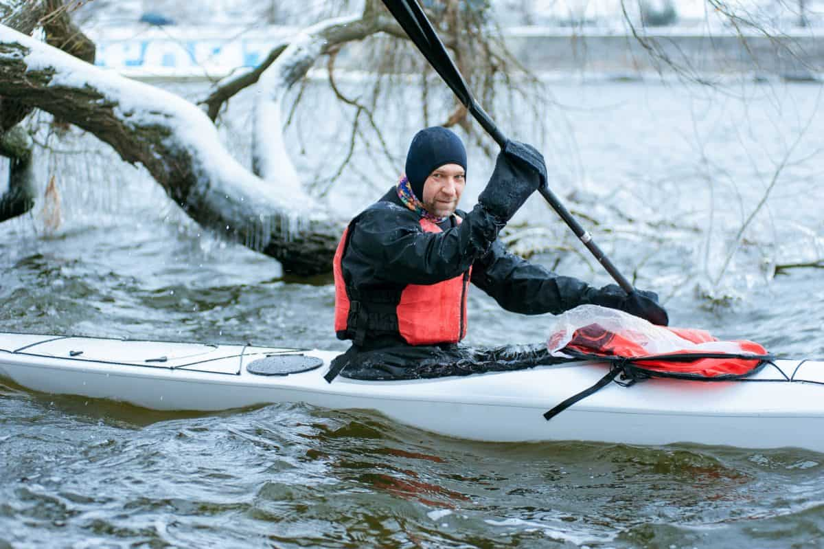 kayaking gloves - Kayker wearing Pogies on icy waters