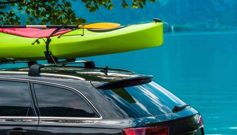 Kayak Roof Rack and the Green Kayak Mounted on the Vehicle Roof.