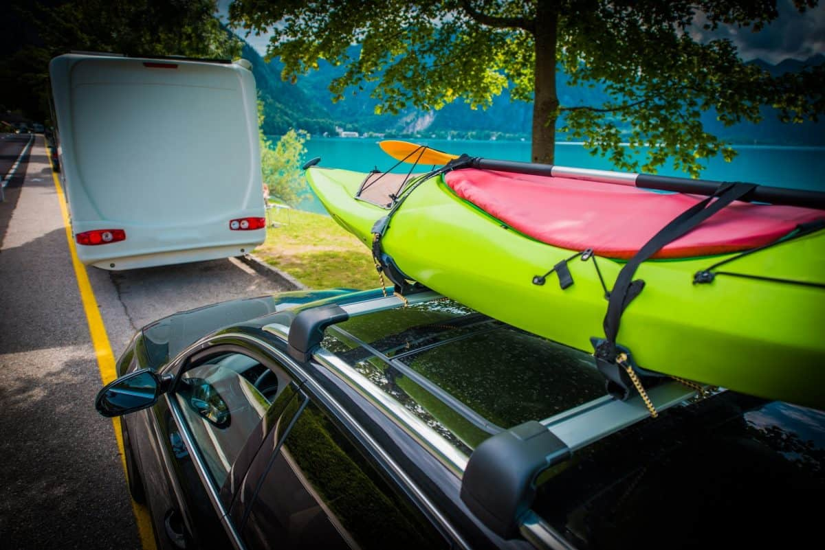 Green Kayak Transportation on the Car Roof Rack.