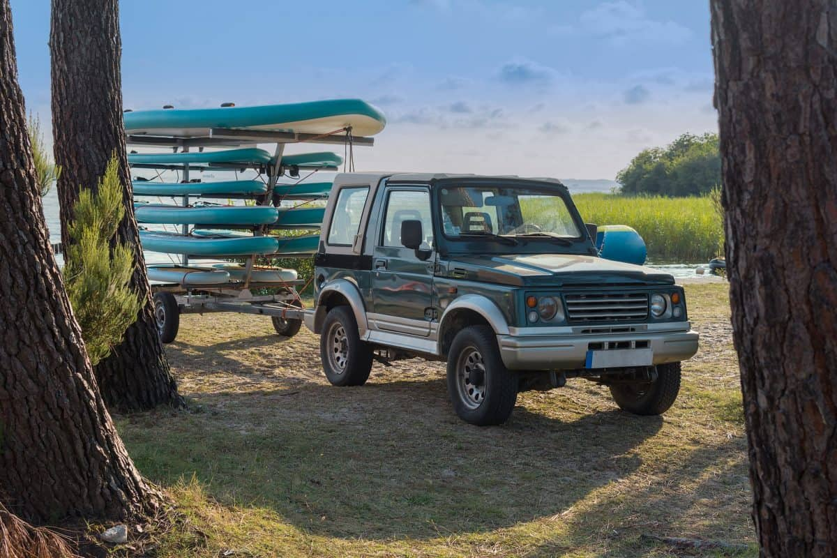 Trailer with kayaks and paddles