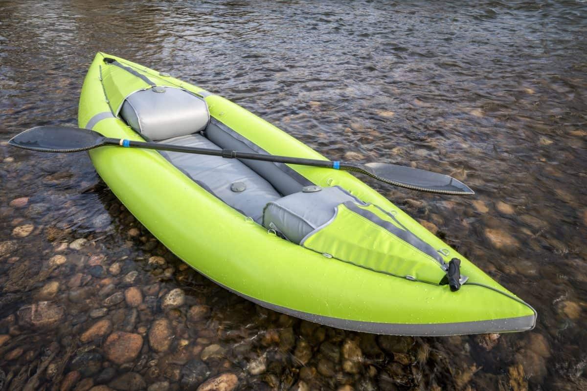 inflatable kayak on shallow rocky river