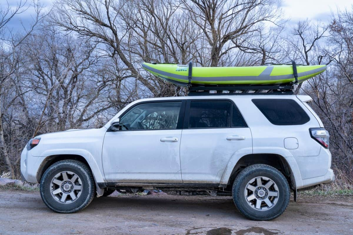 oyota 4runner and whitewater inflatable kayak on roof rack