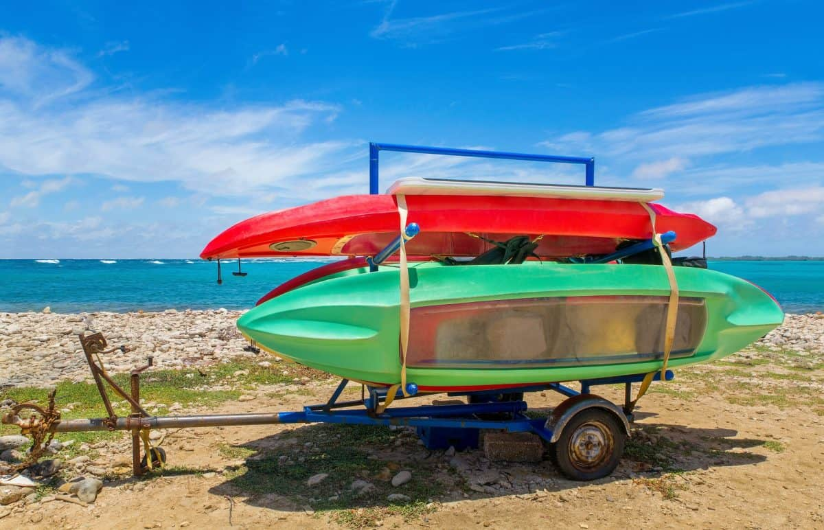Trailer with canoes on beach