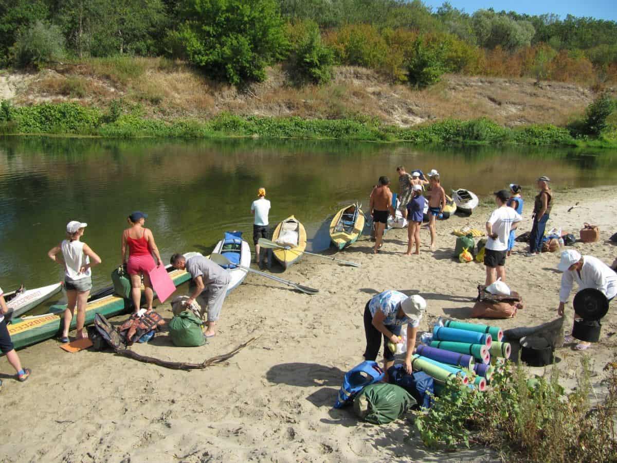 group big guys and big guys preparing for kayaking trip