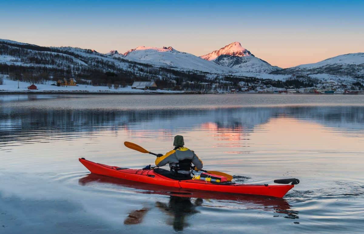 Kayaking in winter landscape