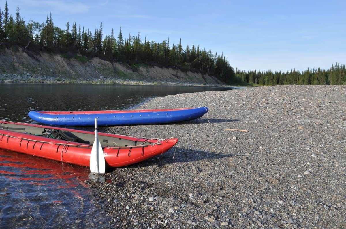 2 Inflatable kayaks on the shore taiga rivers
