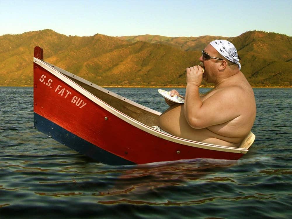 Fat man in Kayak