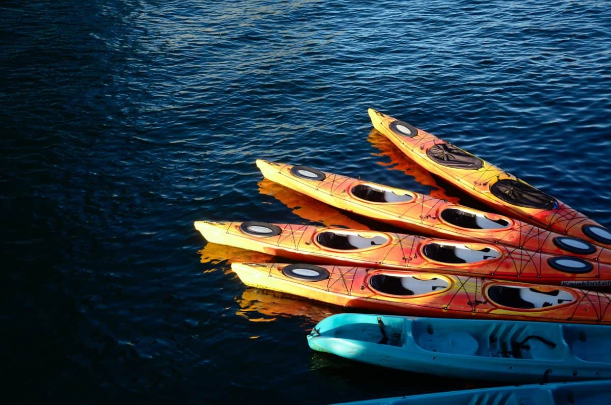 Collection of big guy kayaks on the water