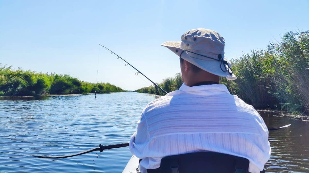 Man in tandem fishing kayak