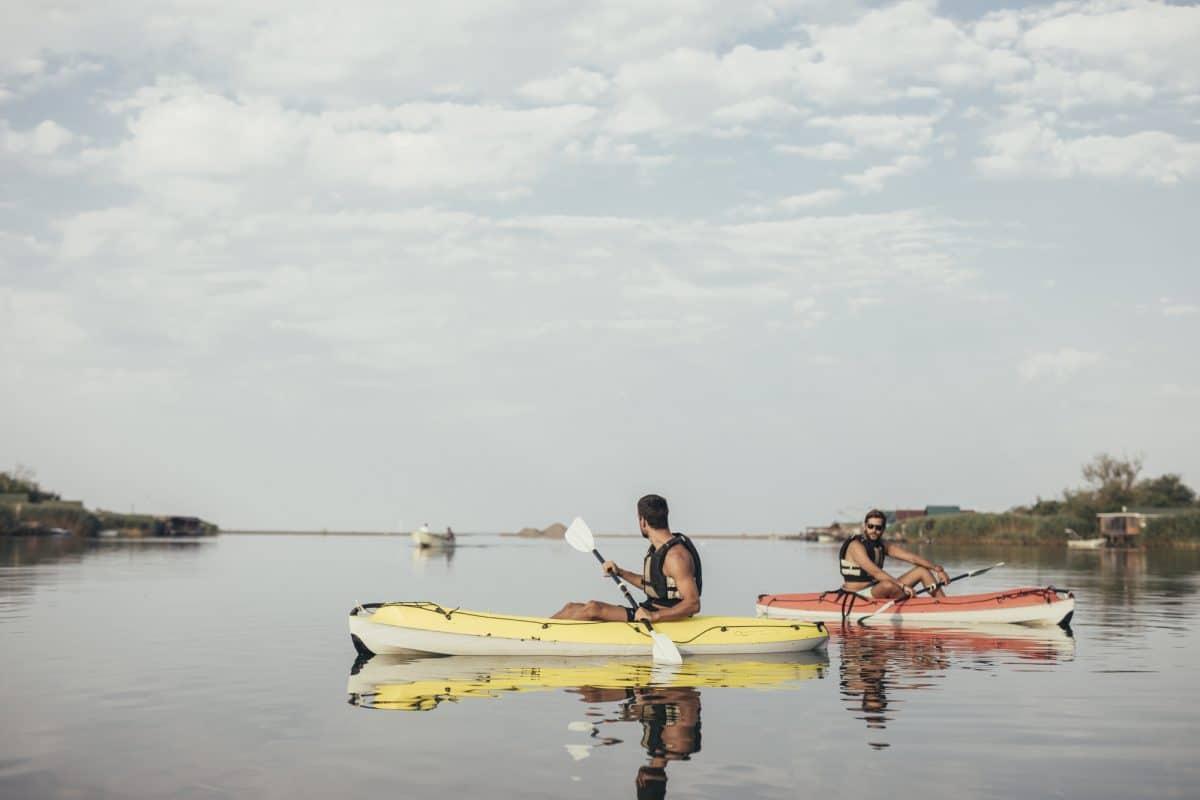 Man on lake in SIt-On-Top Kayak