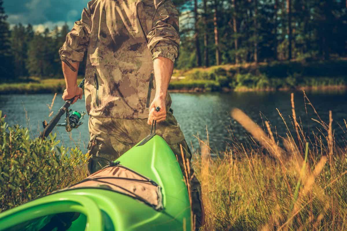 Fisherman Wearing Camouflage with Tandem Kayak .