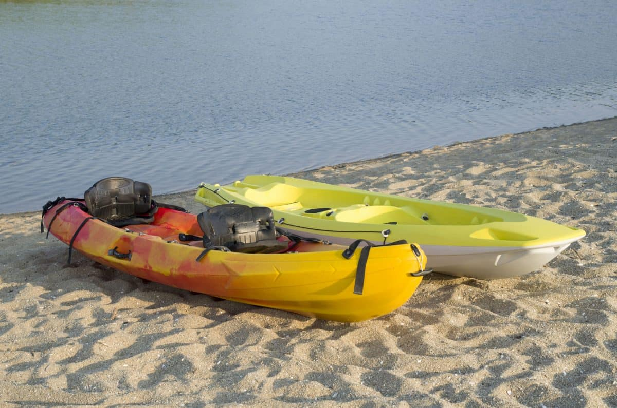 Two different types of kayak two-seat sit-on-top, with black kayak seat