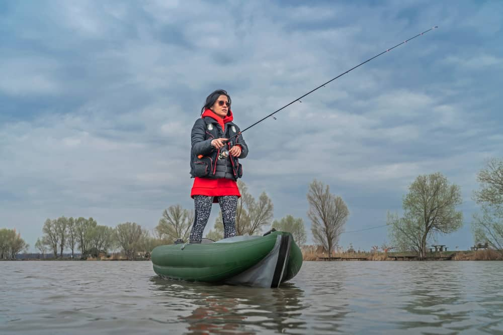 Lady In stand up fishing kayak