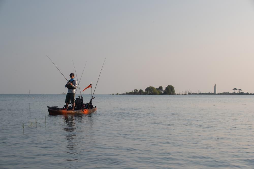 Man in stand up fishing kayak
