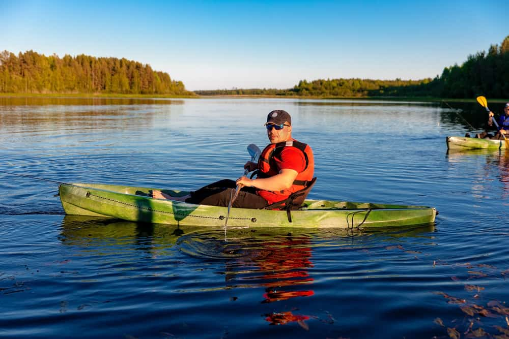Man in Green Kayak with Anchor trolley