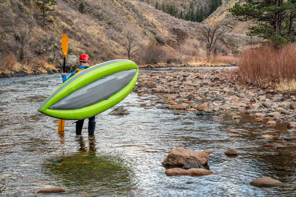 Man carrying lightweight kayak