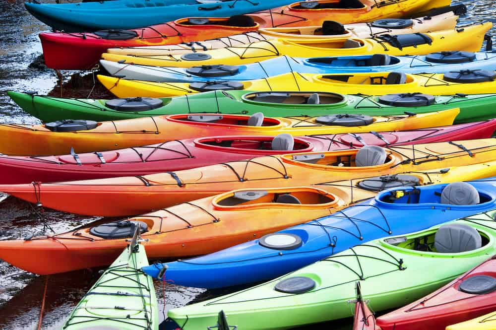 Collection of coloured kayaks