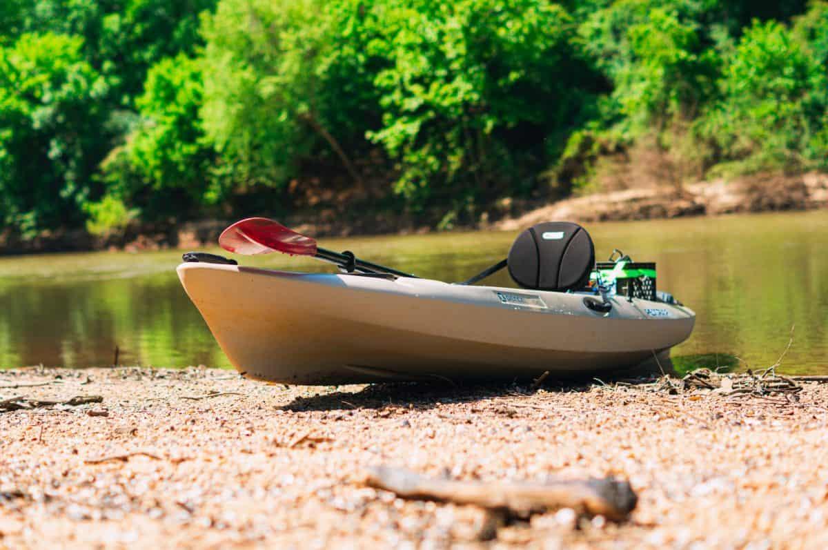 Grey Kayak on Shore black kayak seat