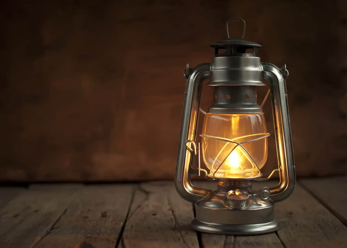 Oil Lamp at Night on a Wooden Surface