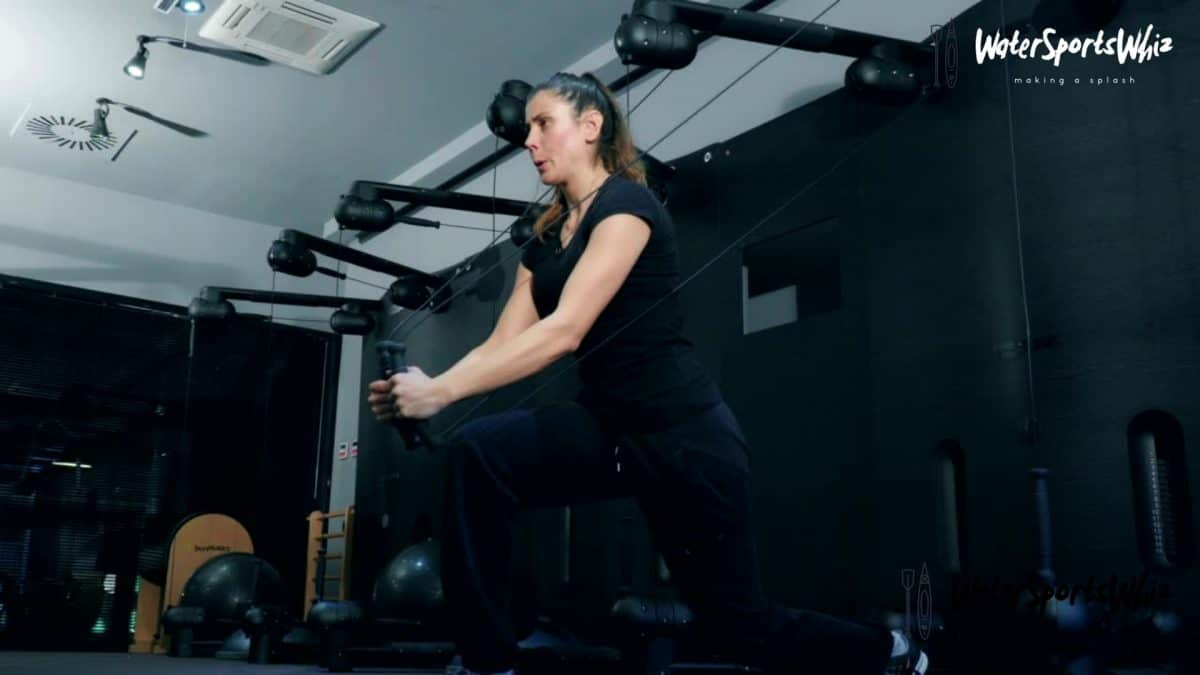 Women performing cable wood chop exercise