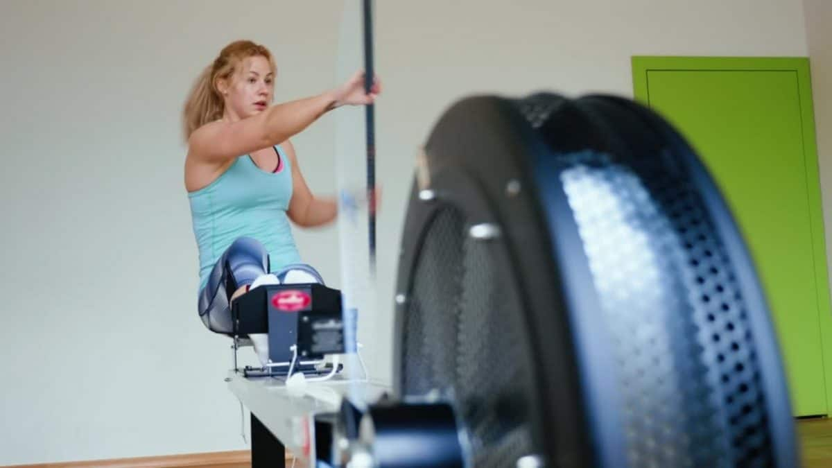 Woman on a rowing machine adapted for kayking