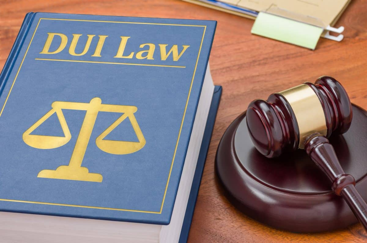 A law book with a gavel - Kayak DUI Law