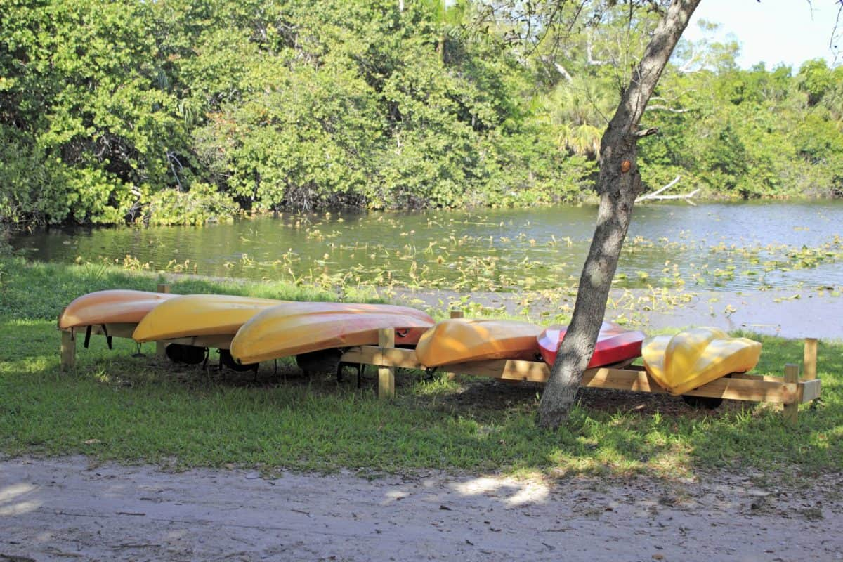 Kayak dying in the sun next to the lake