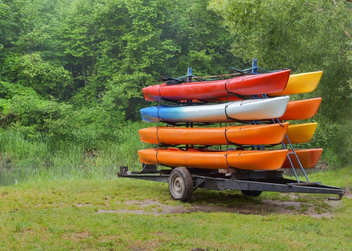 Kayaks on the trailer with eight canoes, kayaks by car delivered to the river