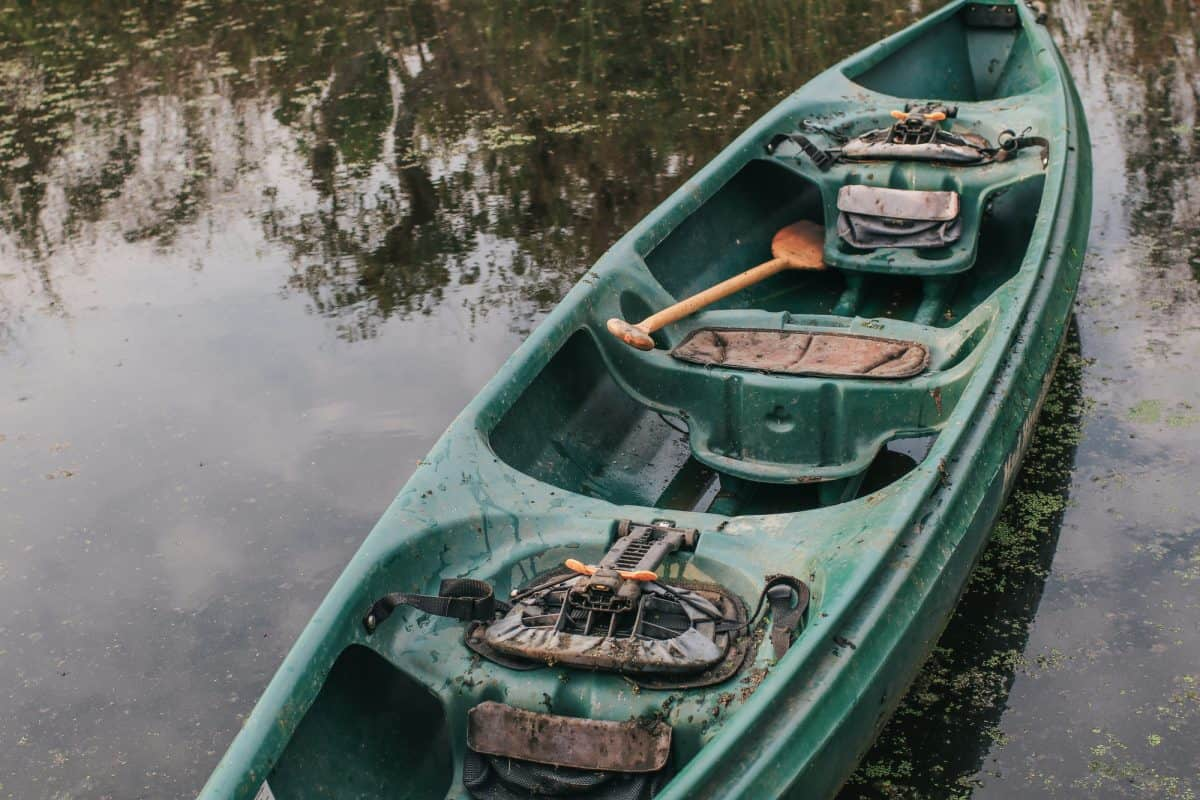 DIrty kayak in grey and dark water