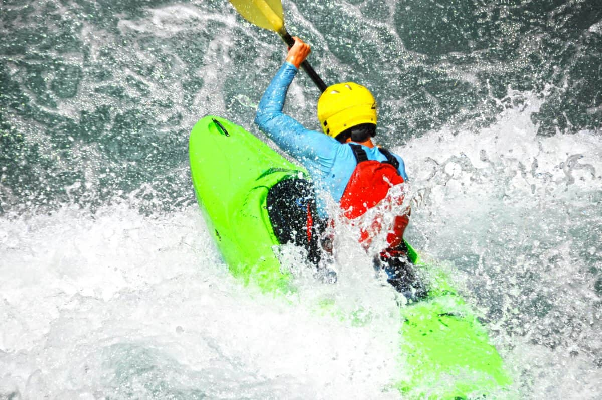 Kayaker caught in the boil of a low-head dam