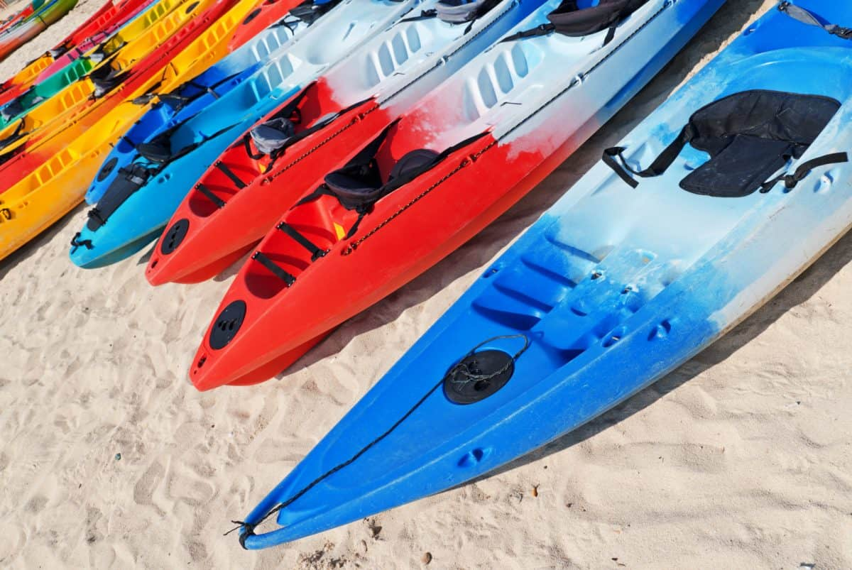 Colourful kayaks on the beach.
