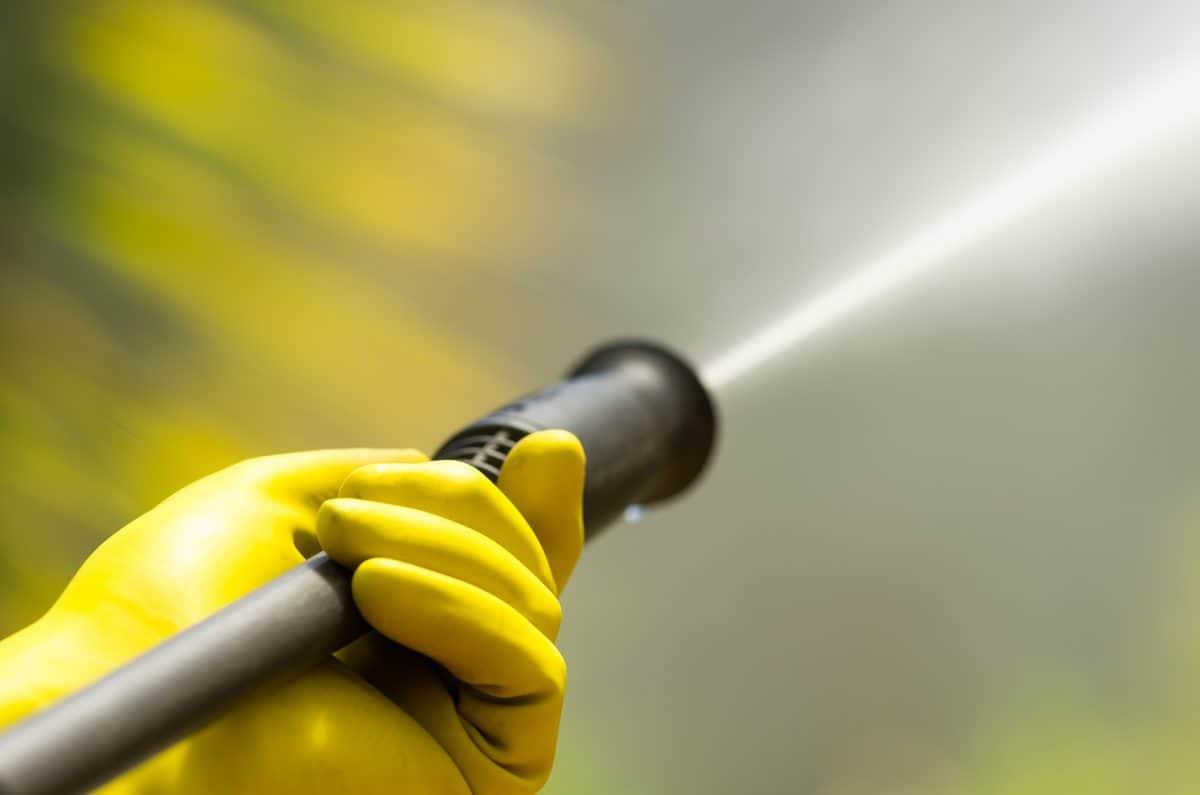 Kayak wax - Closeup black head of high pressure water cleaner as waterbeam emerges.
