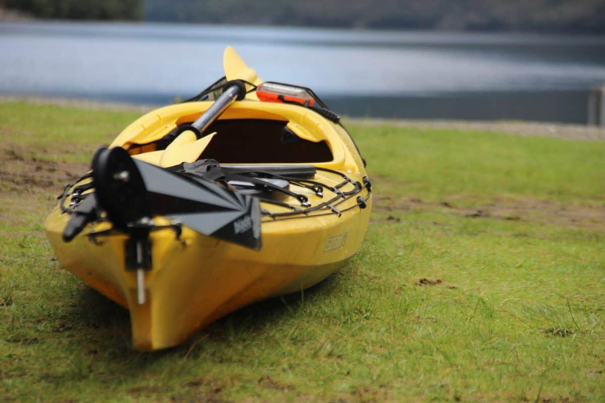 Dirty Kayak laying by the river