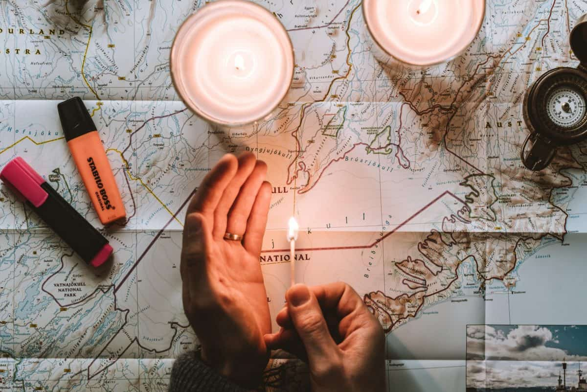Man planning his trip using a large scale map