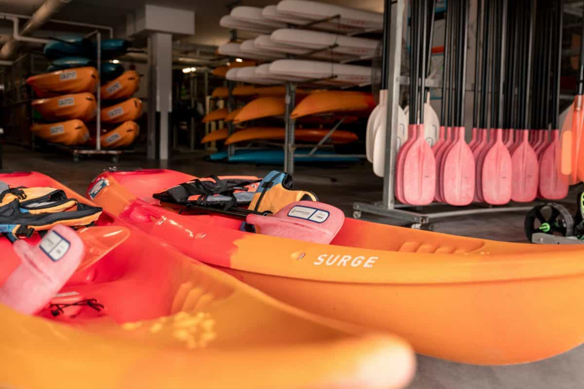Orange sit on top kayak in store