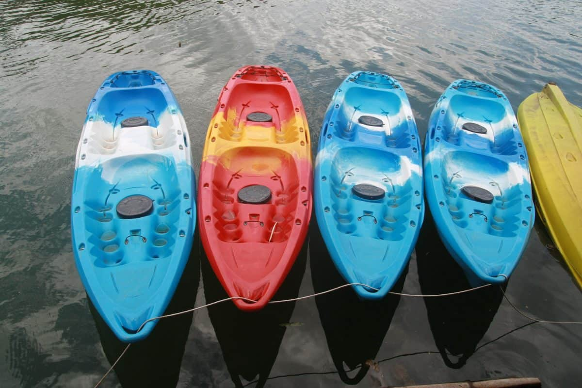 4 sit-on-top kayaks with scupper plugs