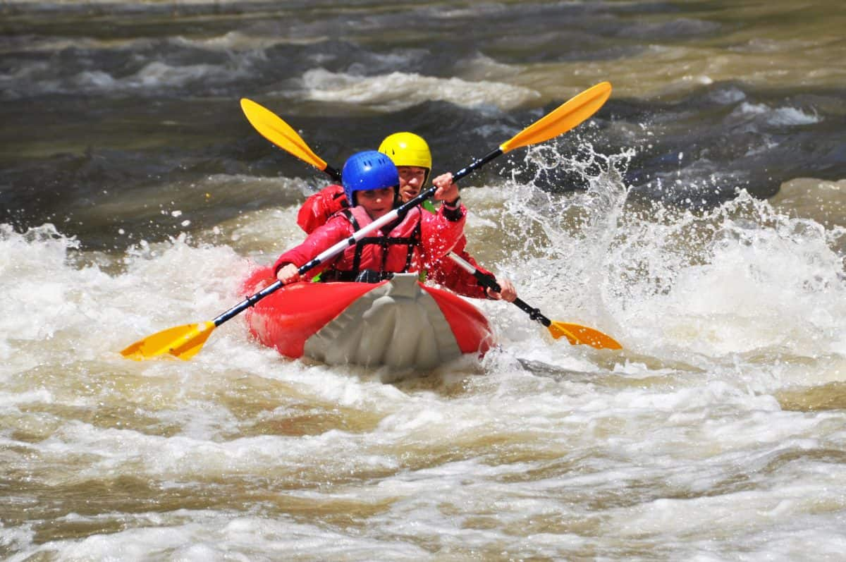Kayak Duckie with two paddler in whitewater