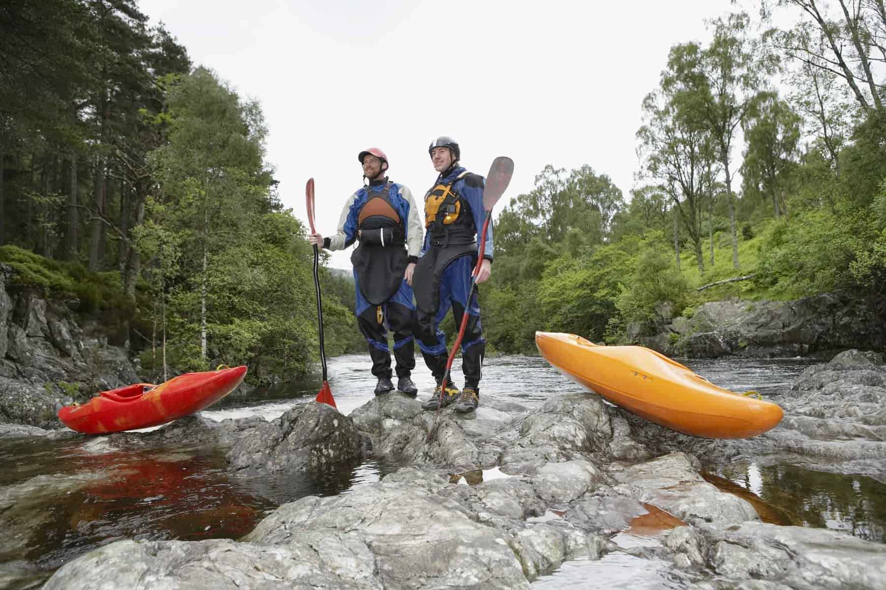 2 guys in full Kayaking Clothing holding paddles
