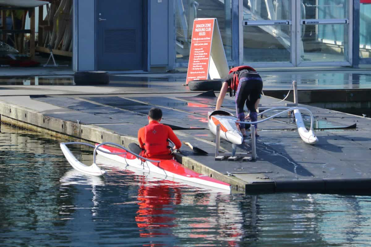 get into a kayak from a dock side