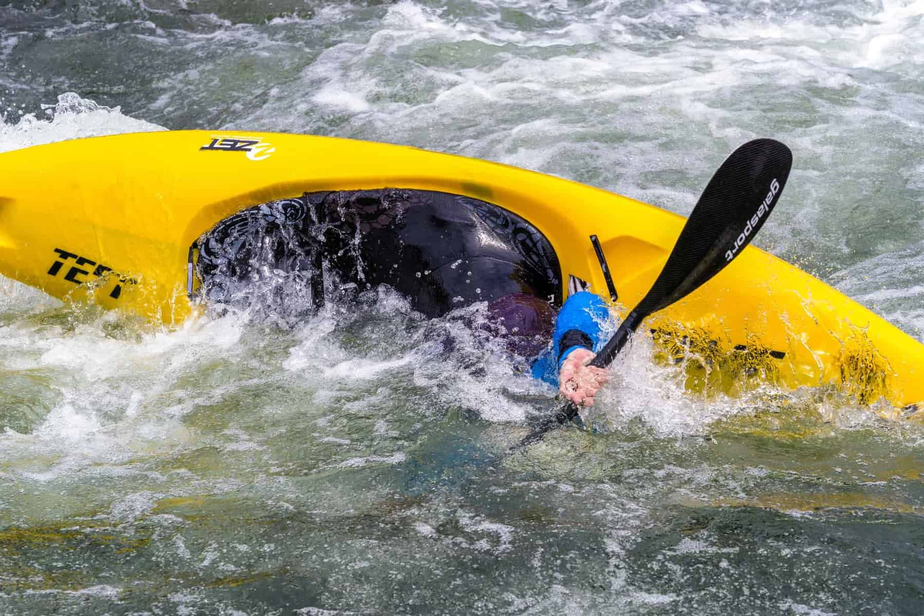 Kayaker demonstrating the Roll the C to C