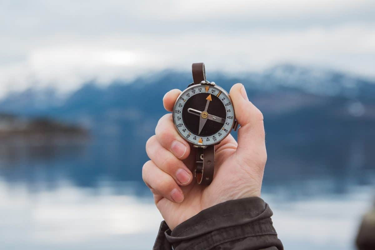 hand holding compass for kayaking winner