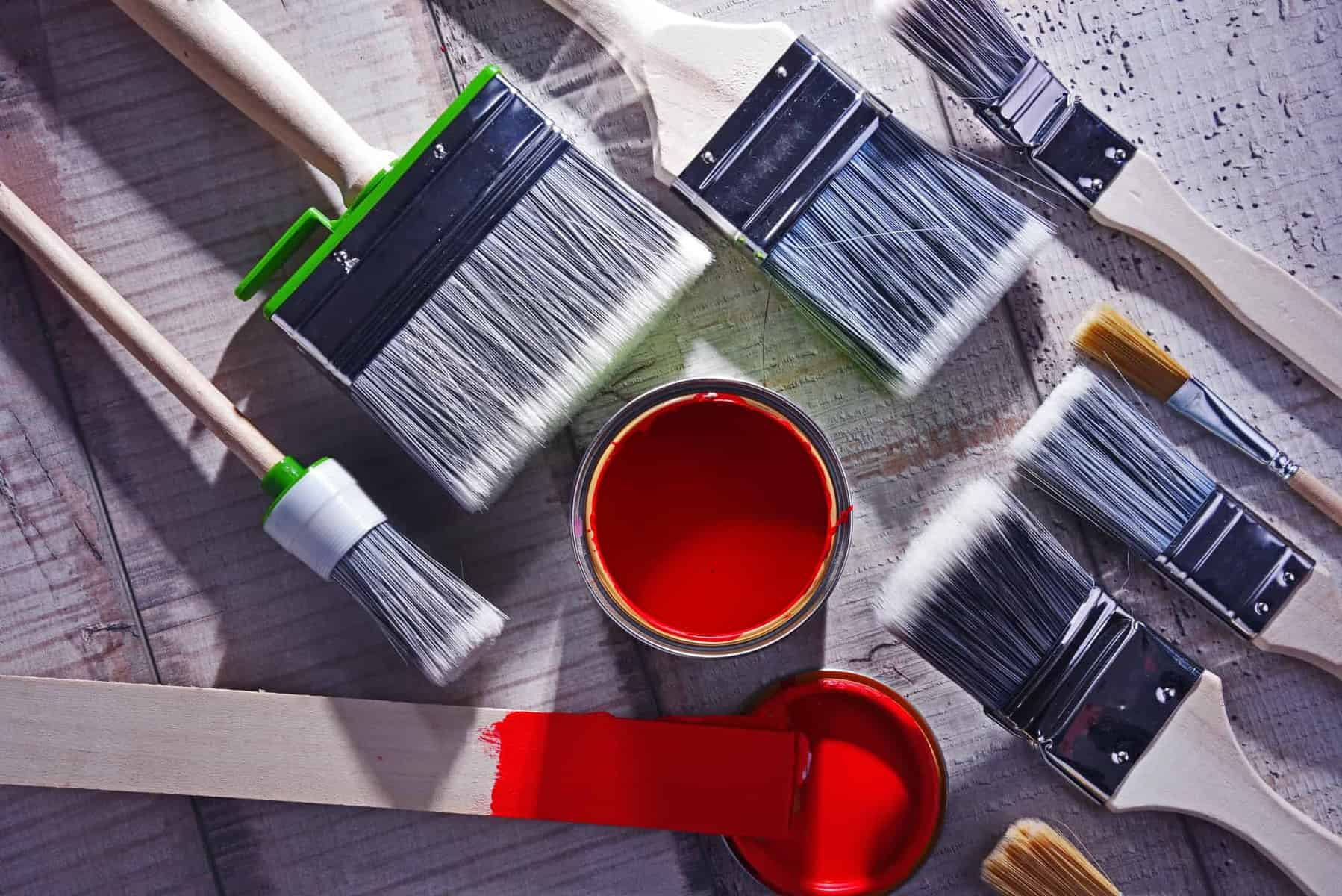Can you paint a kayak - tin of red paint and collection of brushes