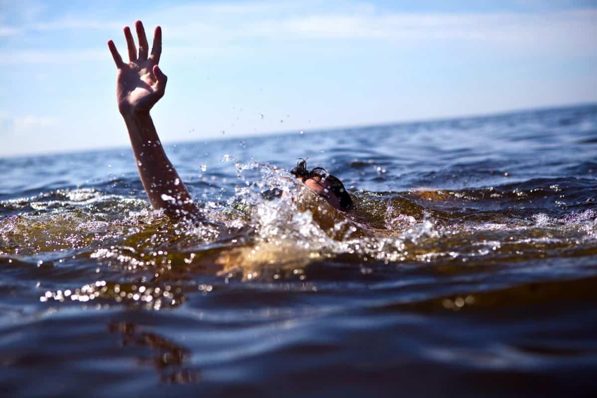 kayaking risk of Drowning - man struggles in water