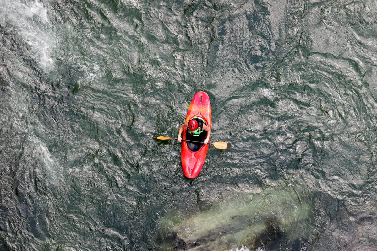 upstream and downstream kayaking in red play boat