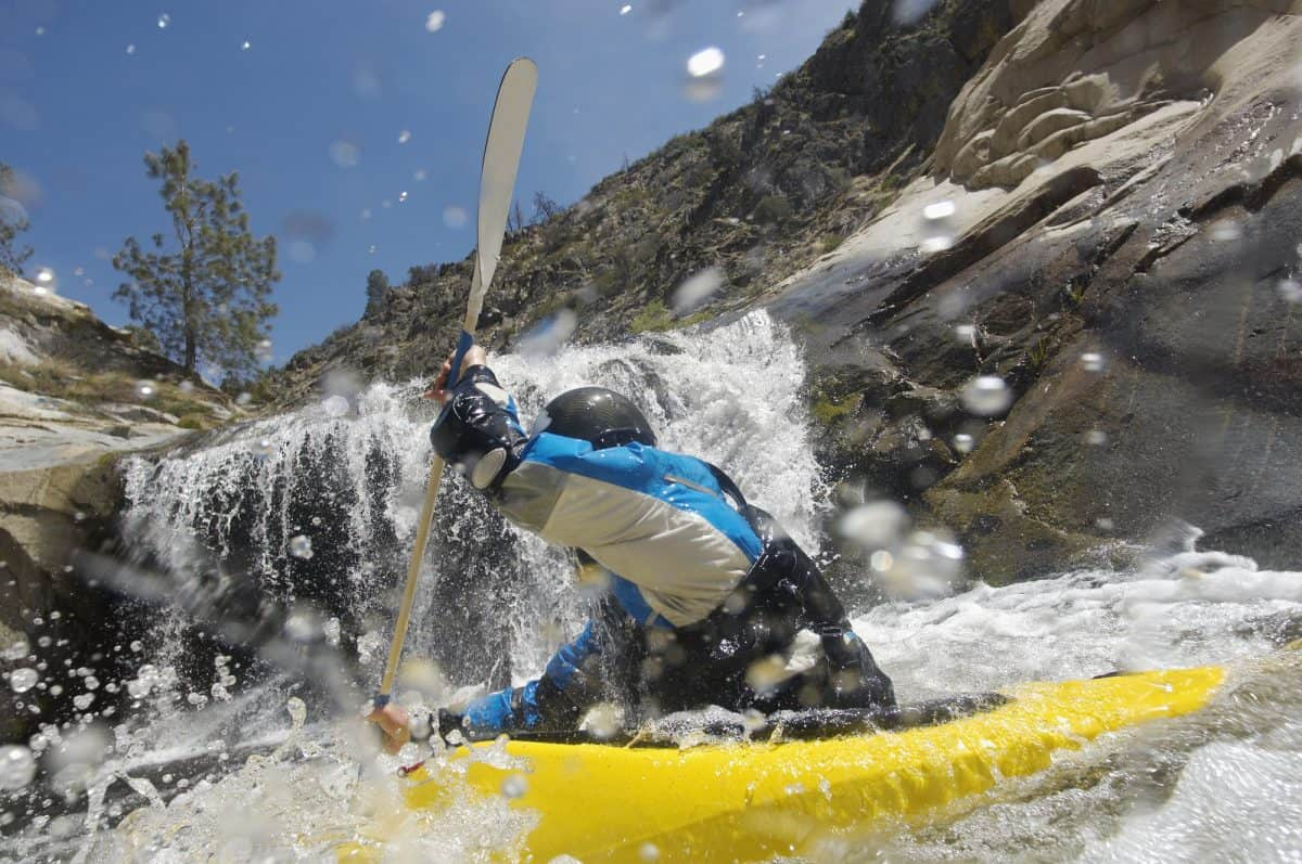 kayaker in yellow recreational kayak for rivers