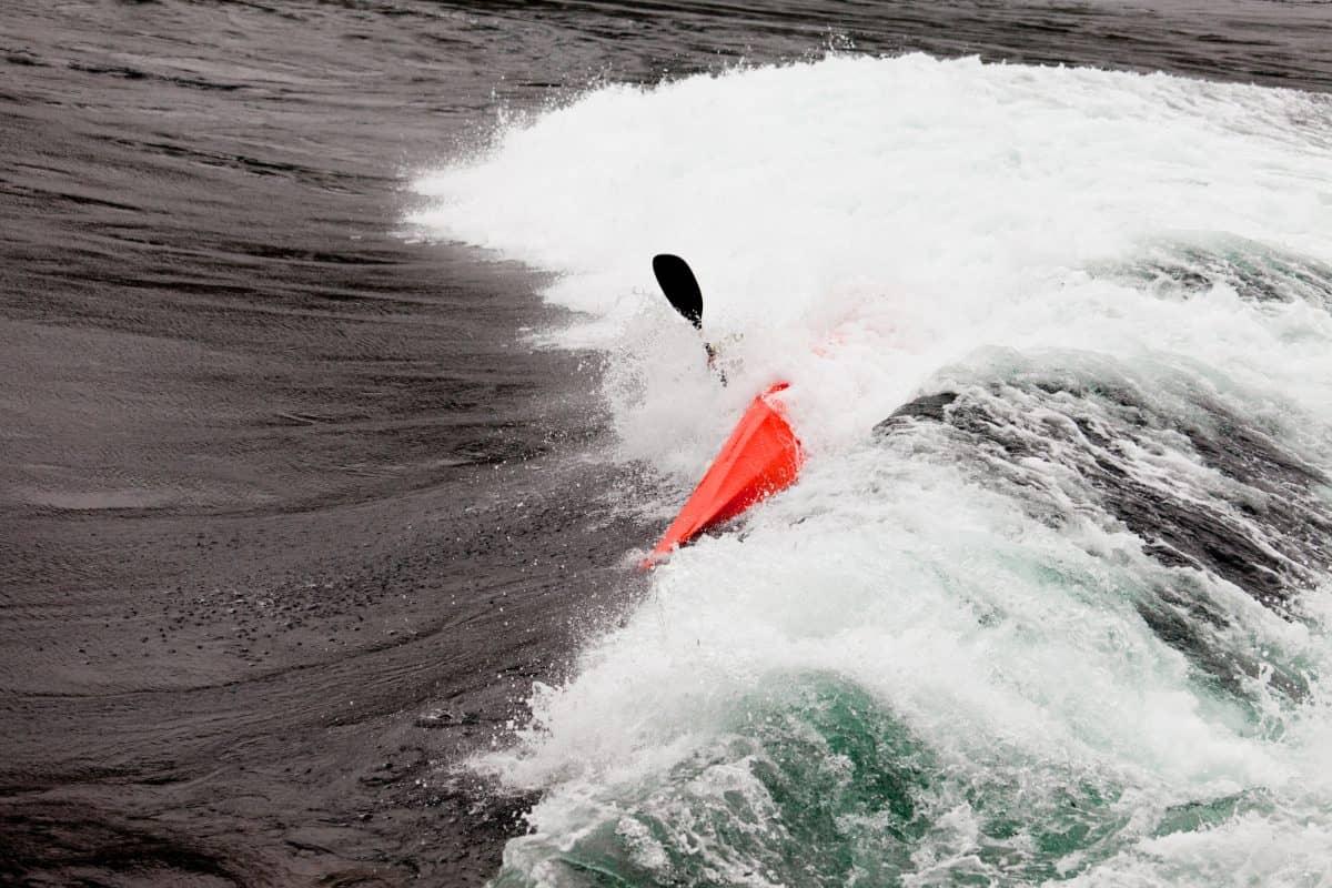 hazards of kayaking - waves overcome kayaker