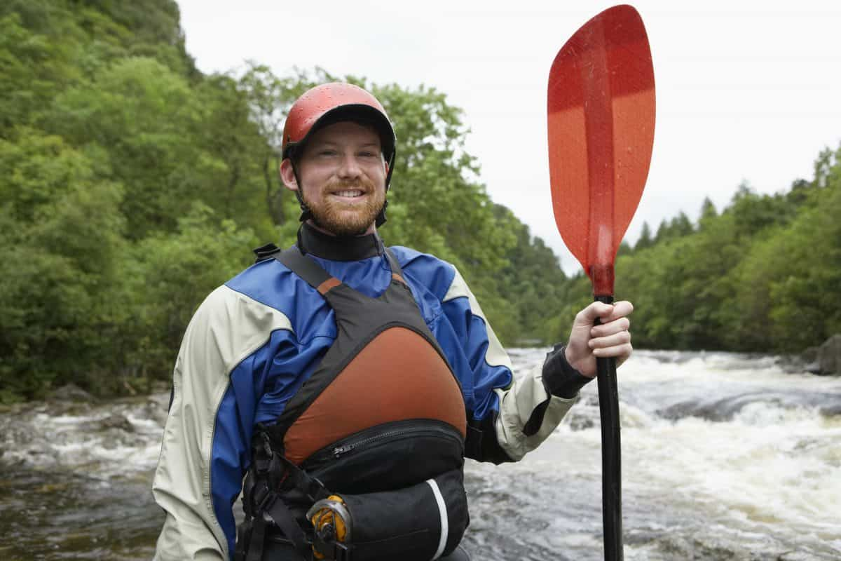 man demonstrating upstream paddling safety equipment
