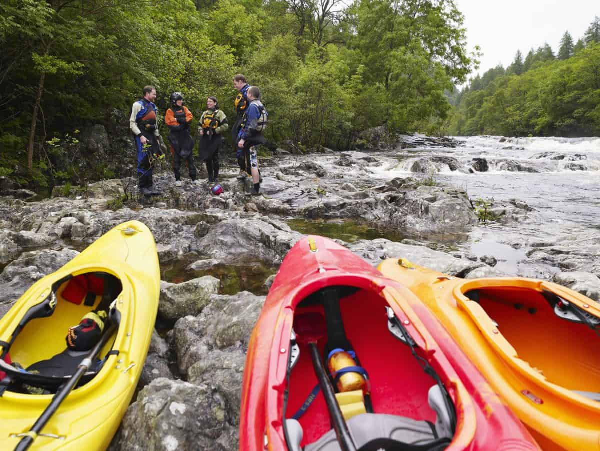 Group of 3 best river kayaks on the river bank